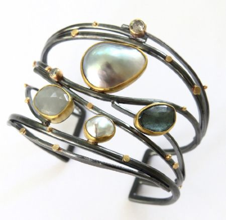 I can't make enough Twig cuffs! This dreamy, silver-gray bracelet includes a...