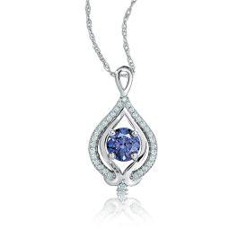This beautiful pendant features a striking round tanzanite gemstone center surro...