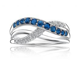 This diamond crossover ring is set in 10k white gold with 2mm sapphire stones ac...