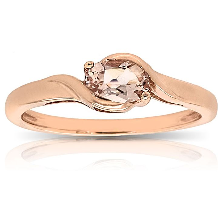 This gorgeous 6x4mm oval-cut morganite gemstone ring is beautifully set in smoot...