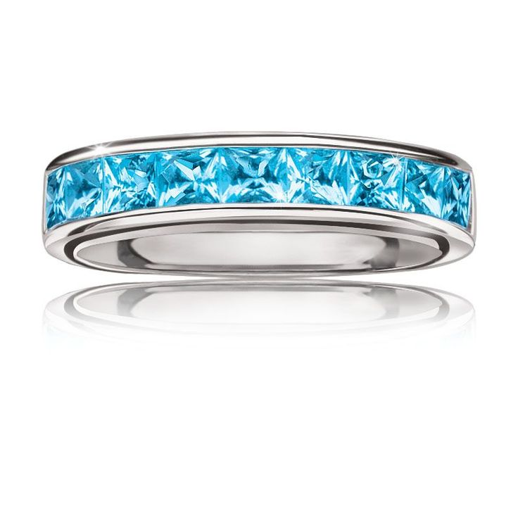 This stackable ring is set in sterling silver with nine square-shaped blue topaz...