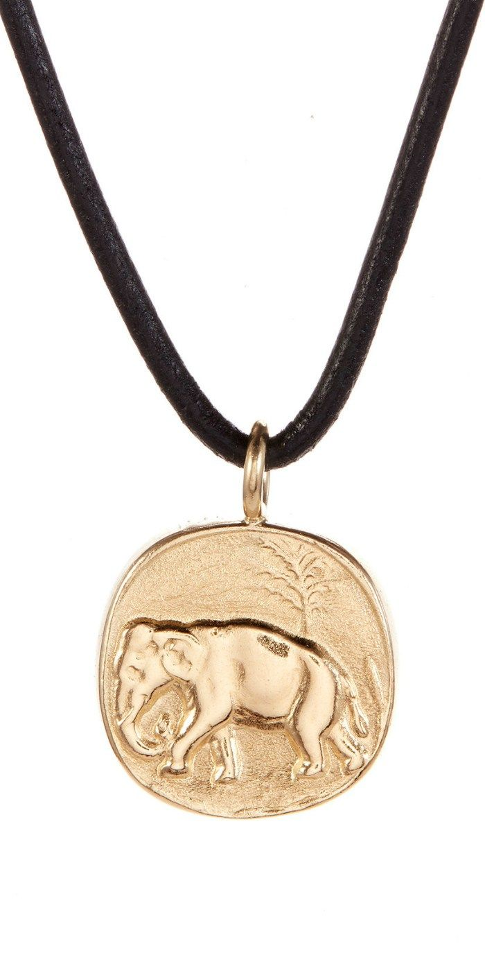 I love this gold elephant pendant necklace by Andrea Gutierrez! Available at The...