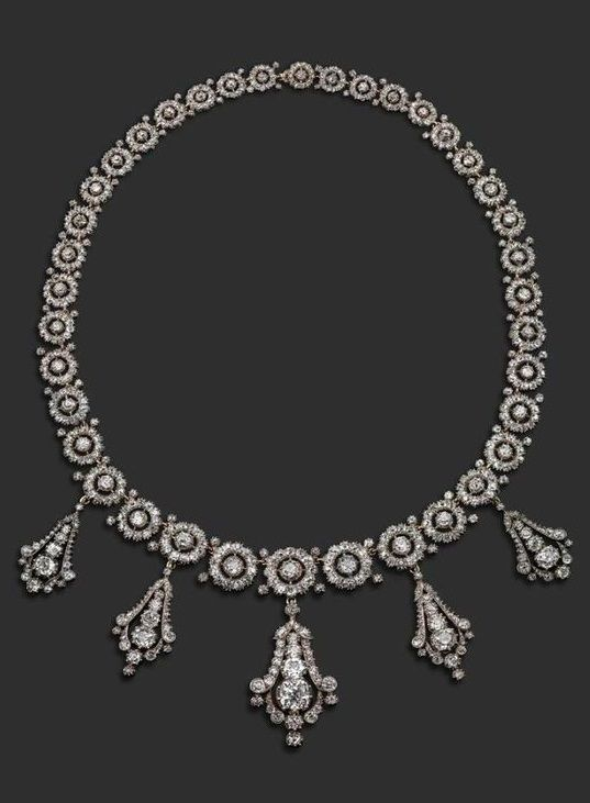 A late Victorian diamond necklace, formed with graduated circular links, each ce...