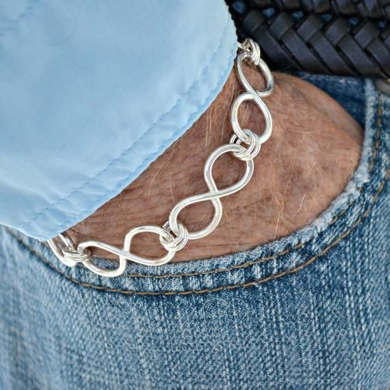 Hand forged solid sterling silver Infinity Link bracelet. The perfect way to say...