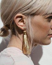 Big, gold, dangling tassel earrings