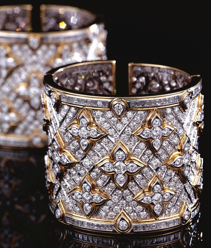 PAIR OF DIAMOND CUFF BANGLES, REPOSSI.  Each hinged cuff designed as a wide band...