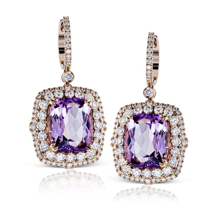 These dazzling geometric-shaped contemporary earrings are accentuated by the pre...