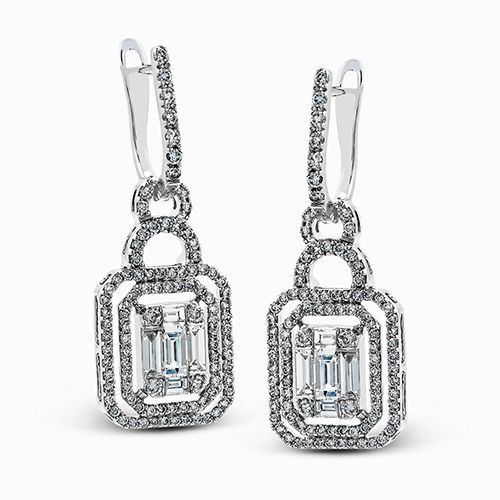 These impressive contemporary earrings feature a stunning geometric design suspe...