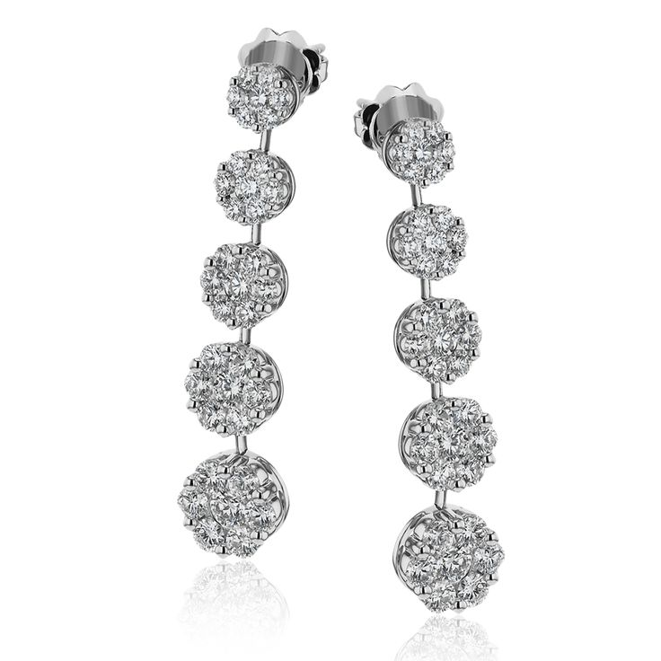 These lovely floral earrings have a touch of 60s inspired vintage feeling, with ...