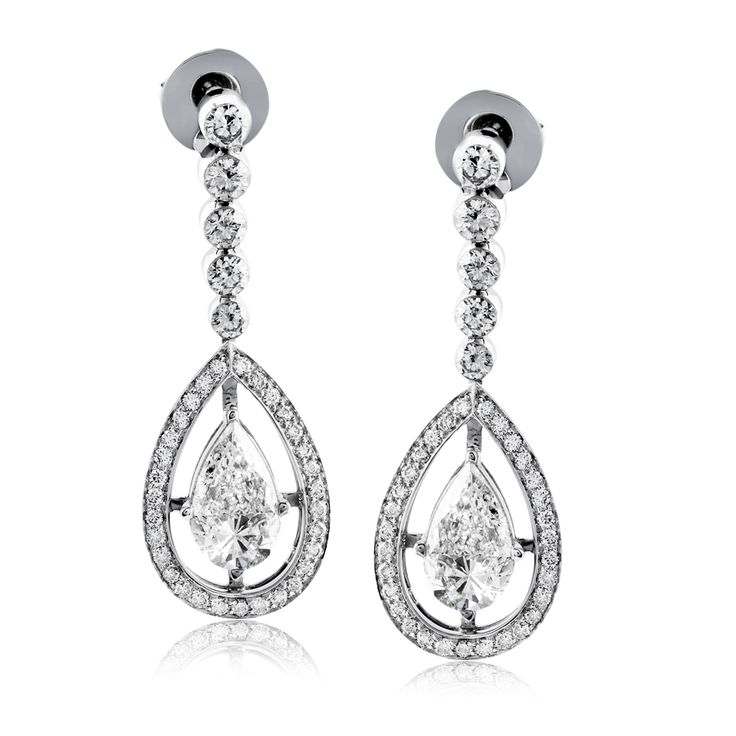 These remarkable 18k white gold drop earrings have a wonderful design set with 1...
