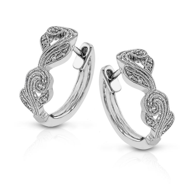 These vintage-inspired hoop earrings have a milgrain accented filigree design an...