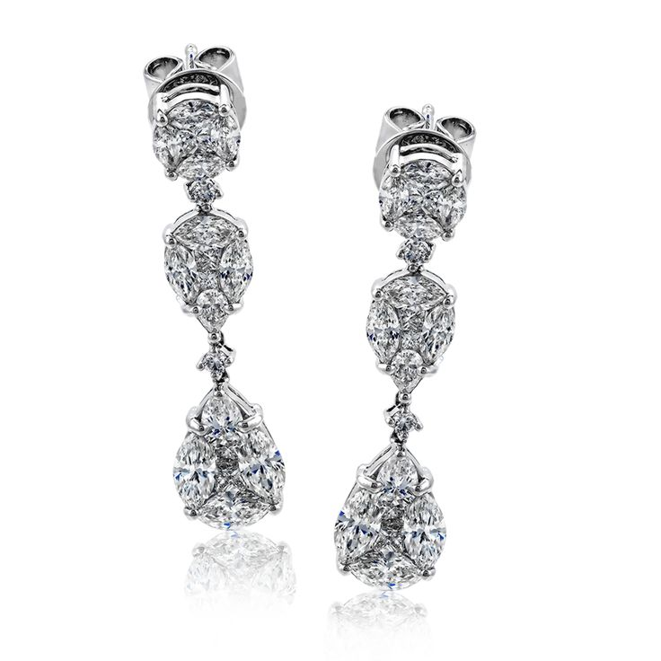 This drop earrings sparkle with .10 ctw of round diamonds, .61 ctw of pear shape...