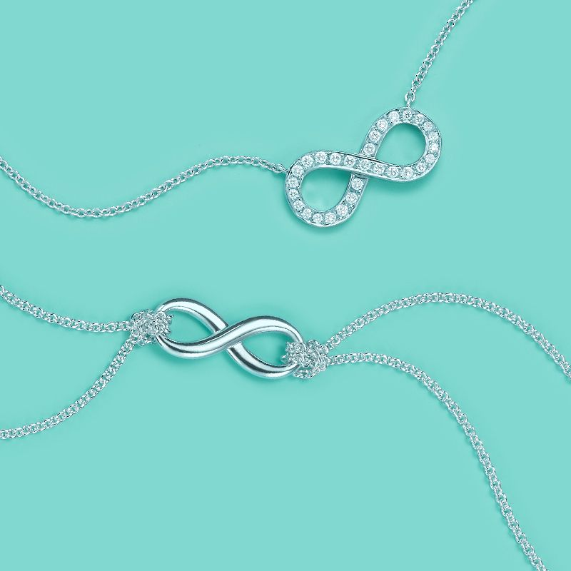 Tiffany Infinity pendants, from top: platinum with diamonds and sterling silver...